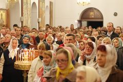 People in the church. A crowd of people in the church. Belarus, Gomel city, celebrating the church holiday of Easter in St. Nicholas Monastery 01.05. 2016 year Stock Photography