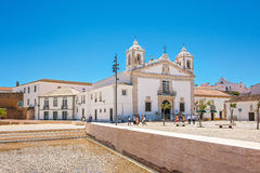 People by the church in Lagos, Portugal Royalty Free Stock Images