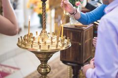 People in the church put candles lit. royalty free stock photo