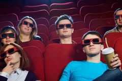 People in a cinema. Group of people in 3D glasses watching movie in cinema stock photo