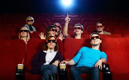 People in a cinema. Group of people in 3D glasses watching movie in cinema royalty free stock photo