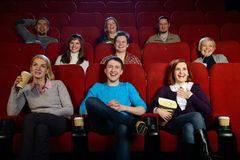 People in a cinema. Group of smiling people watching movie in cinema royalty free stock images