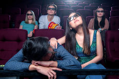People in the cinema wearing 3d glasses Stock Photo