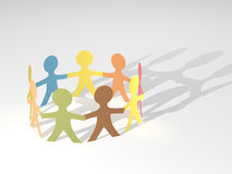 People circle: diversity, friendship, teamwork. Circle of paper people cutouts holding hands signifying diversity, friendship or teamwork. Computer generated Royalty Free Stock Image