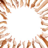 People in a circle holding thumbs up Stock Photos