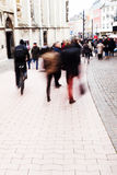 People in the city with creative zoom effect. Crowds of people on the move in the city with creative zoom effect, created by zooming  the lens Stock Images