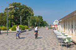 People in the city cycling along Dnepr river embankment. Dnepropetrovsk, Ukraine - August 15, 2015: People in the city cycling along Dnepr river embankment at royalty free stock photo