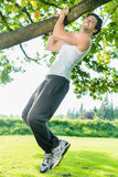 People in city park doing chins or pull ups Stock Photography
