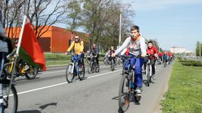 People in the city ride bicycles, close-up, bicycle wheels, background, healthy lifestyle Belarus, Bobruisk - May 1 stock video