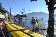 People of civil Protection pumping water of the inundation of la. Lugano, Switzerland - 18 November 2014: People of civil Protection pumping water of the Royalty Free Stock Photography