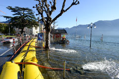 People of civil Protection pumping water of the inundation of la. Lugano, Switzerland - 18 November 2014: People of civil Protection pumping water of the Royalty Free Stock Photos