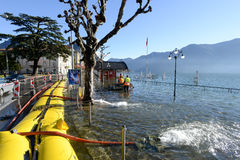 People of civil Protection pumping water of the inundation of la. Lugano, Switzerland - 18 November 2014: People of civil Protection pumping water of the Royalty Free Stock Image