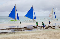 People clean the beach in Boracay, Philippines Royalty Free Stock Photo