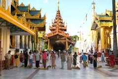 People cleaning with brooms the area of the Shwedagon Pagoda in Stock Photography
