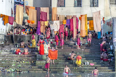 People cleaning clothes and washing in the river Ganges in Calcu Stock Photos