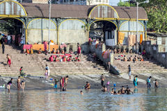 People cleaning clothes and washing in the river Ganges in Calcu Royalty Free Stock Photography