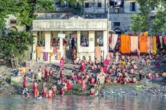 People cleaning clothes and washing in the river Ganges in Calcu Stock Photo