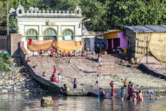 People cleaning clothes and washing in the river Ganges in Calcu Royalty Free Stock Photo