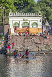 People cleaning clothes and washing in the river Ganges in Calcu Royalty Free Stock Images