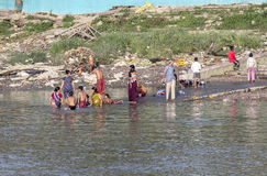 People cleaning clothes and washing in the river Ganges in Calcu Stock Images