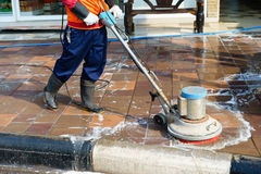 People cleaning floor with machine. Royalty Free Stock Photography