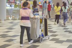 People cleaning floor in the mall stock images