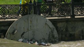 People Cleaning Polluted City River stock video footage