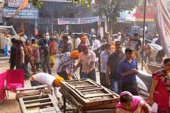People cleaning the street after Guru Nanak Gurpurab celebration Royalty Free Stock Photo