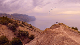 People on a cliff Royalty Free Stock Images