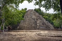 People climb and descend from the pyramid. In the Mayan city of Koba. Mexico royalty free stock photos