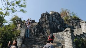 People climb the mountain. TAM COC, VIETNAM - DECEMBER 19, 2018: Popular vietnam destination - people climb the mountain, 500 steps to a lookout with iconic stock video footage
