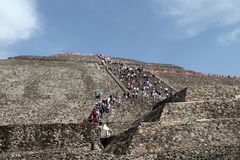 Mexico City. People climb the Pyramid of the Sun at the site of Teotihuacan on March 17, 2014 in Mexico City Royalty Free Stock Photos