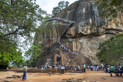 People climb the stairs to the summit of Sigiriya Rock in Sri Lanka. Royalty Free Stock Image