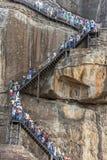 People climb the stairs to the summit of Sigiriya Rock in Sri Lanka. Stock Photography
