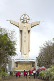People climb to the giant statue of Jesus Christ atop mount Nyo. Vung Tau, Vietnam Royalty Free Stock Image