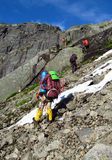People climbers, climbing to the summit, rocky mountain peaks and glacier in Norway Stock Photo