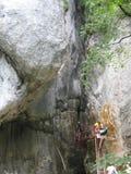 people-climbing-on-canyon-entrance Stock Photo