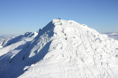 People climbing Chopok Peak, 2024 m. On a bright day stock images