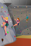 People climbing indoor wall Stock Photo