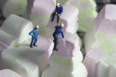 People climbing mini candies Stock Photography