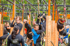 People climbing an obstacle rig. stock photos