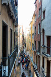 People climbing off elevated walkways in Venice. People stepping down off elevated walkways in Venice, Italy used to provide a dry passage through the city at Stock Images