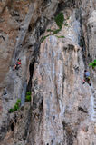 People climbing on the rock route summer Stock Image