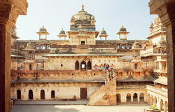 People climbing the stairs of the ancient fort Jahangir Mahal in Madhya Pradesh state Royalty Free Stock Image