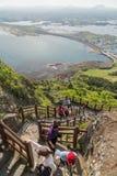 People climbing stairs at the Seongsan Ilchulbong Peak Stock Photo