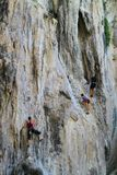 People climbing up a Big Rock - Thailand Stock Image