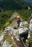 Climbing on via ferrata. People climbing on a via ferrata route in the mountains Stock Photography