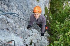 Climbing on via ferrata Stock Photo