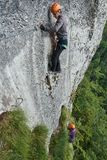 Climbing on via ferrata. People climbing on a via ferrata route in the mountains Stock Image