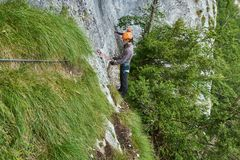 Climbing on via ferrata. People climbing on a via ferrata route in the mountains Stock Images